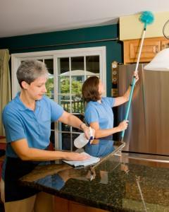 Two Woman Cleaning The Kitchen